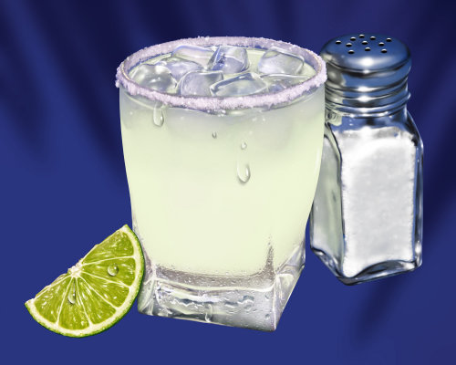Glass of Margarita with slice of Lime and Salt shaker