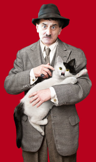 Man in gangster suit holding cat with black moustache
