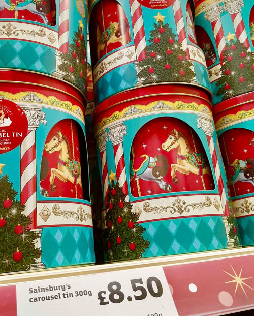 Painting on musical carousel cookie tin