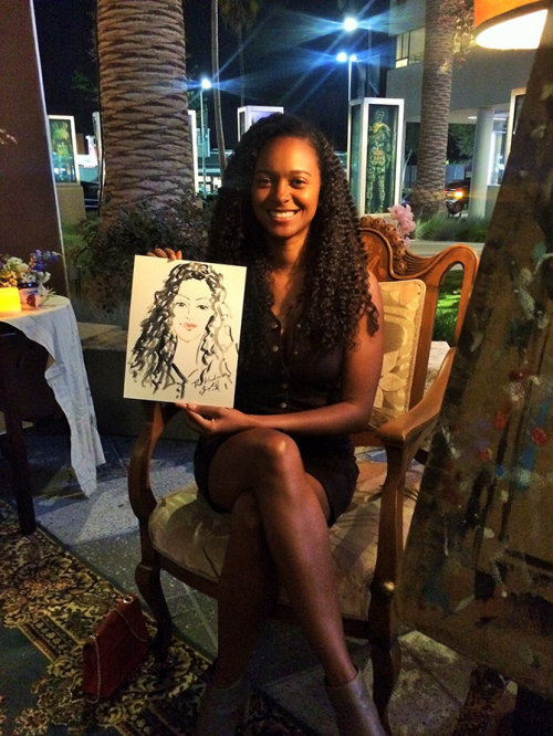 Garota de desenho de evento ao vivo mostrando seu retrato
