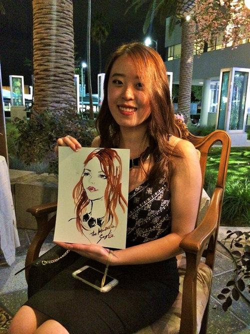 Evento ao vivo desenhando uma garota sorridente com seu retrato