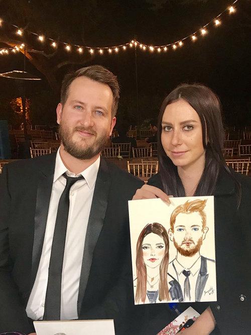 Desenho de casal em evento ao vivo
