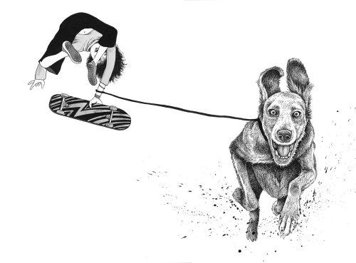 Black & White boy skating with dog