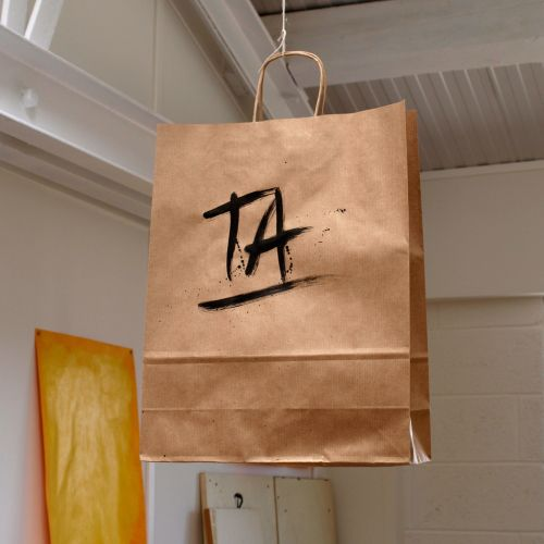 Ta lettering on carrying bag by Tallon Type