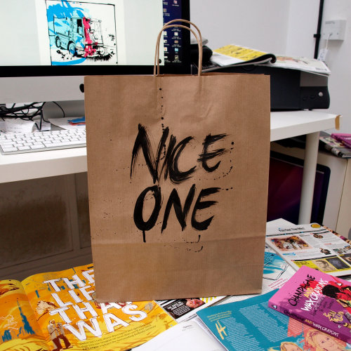 Nice one lettering on carrying bag by Tallon Type