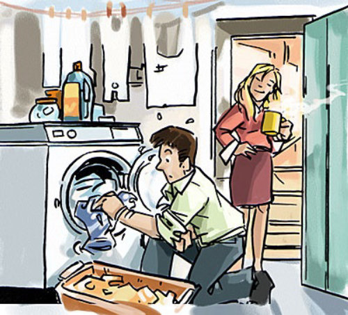 Man taking clothes from a washing machine women looking