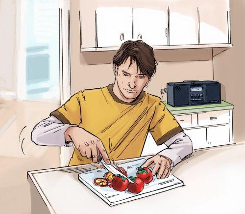 男孩在厨房里切蔬菜,烤箱和架子在后台