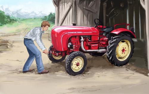 在红色拖拉机前面的人,跟踪器的大和小轮子,