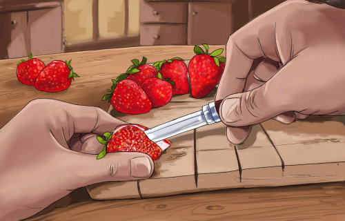 用刀子切割草莓浆果的手,在厨房的桌子上的水果