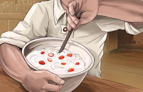 草莓浆果和牛奶混合在一起,用手搅拌容器,准备食物