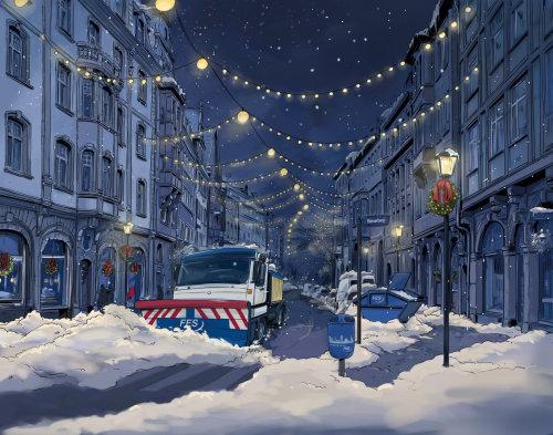 夜晚,灯火通明的街道上,大车辆清除道路上的积雪