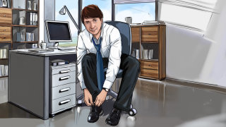Young man in the office and toeing the shoe