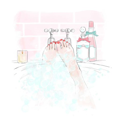 woman in the bath tub washing legs