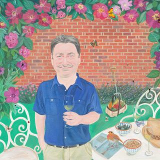 Portrait of Alan Titchmarsh in a garden